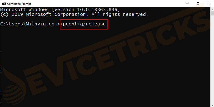 Type the command ipconfig/release and press Enter. Doing so will release the IP address assigned by the DHCP server.